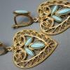 Як носити сережки з бірюзою із золота