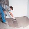 Як вирівняти підлогу під плитку