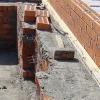 Кладка стін з цегли з утеплювачем усередині