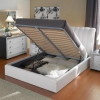 Ліжко з підйомним механізмом: містке сховище для білизни і речей