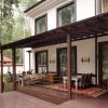 Основні етапи прибудови до дачного будиночка тераси, її обробка і прикраса